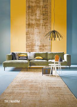 Trendhopper bank Nizan wordt warme toevoeging aan interieur door groene stof