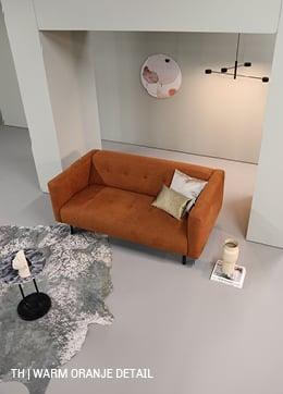 Trendhopper tip voeg warm oranje aardetint toe aan pastel interieur